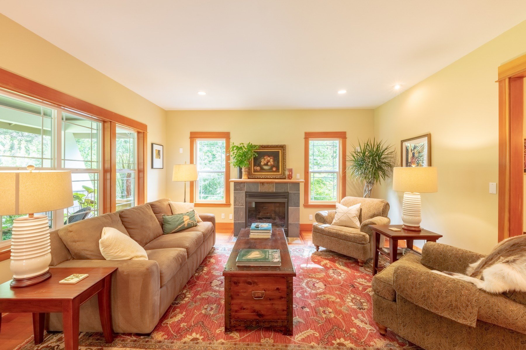 The  living  room  offers  a  gas  fireplace  and  large  windows  that  look  onto  the  gardens.