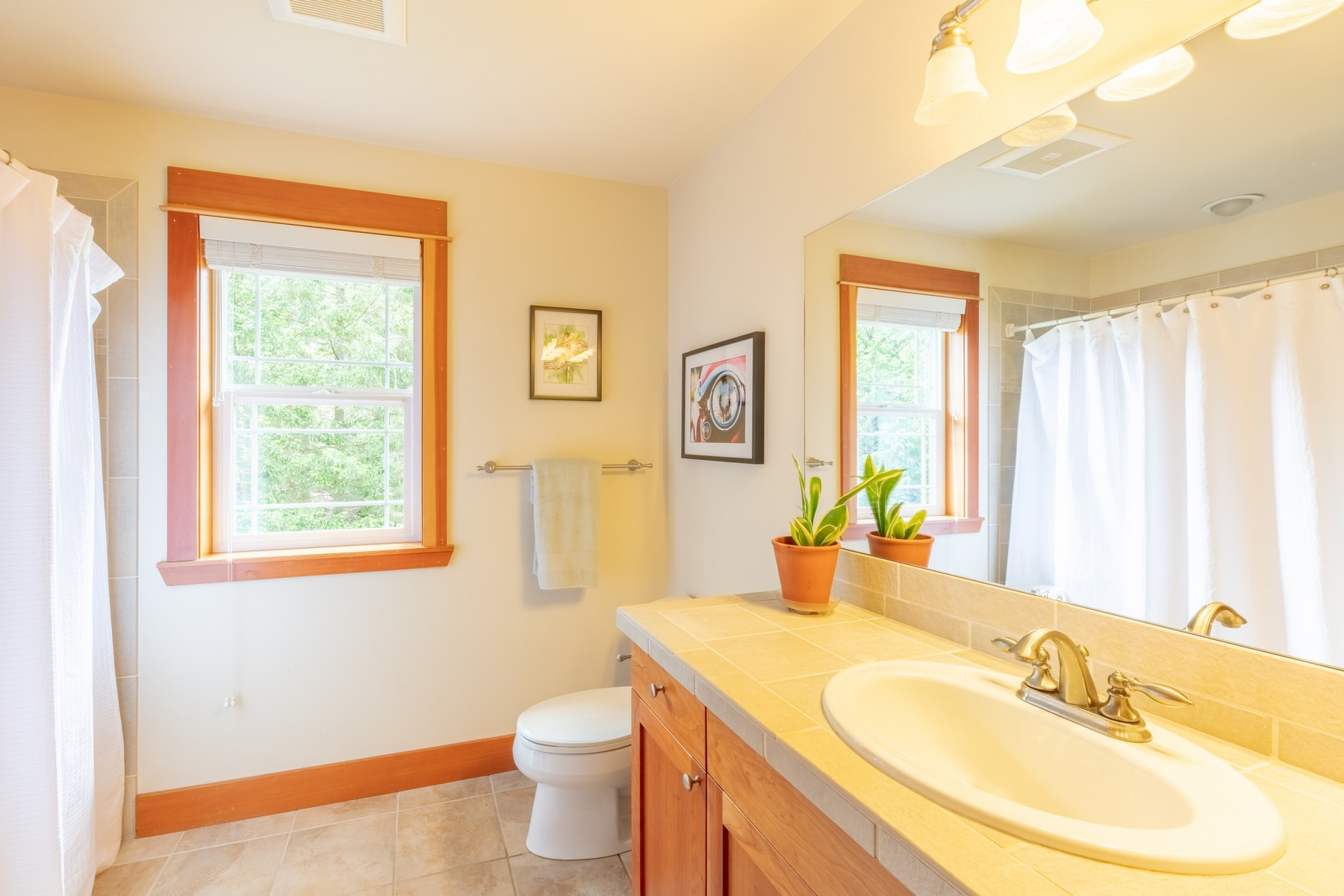 The  second  floor  full  bath  incudes  a  bathtub  and  shower  and  is  tiled  throughout.