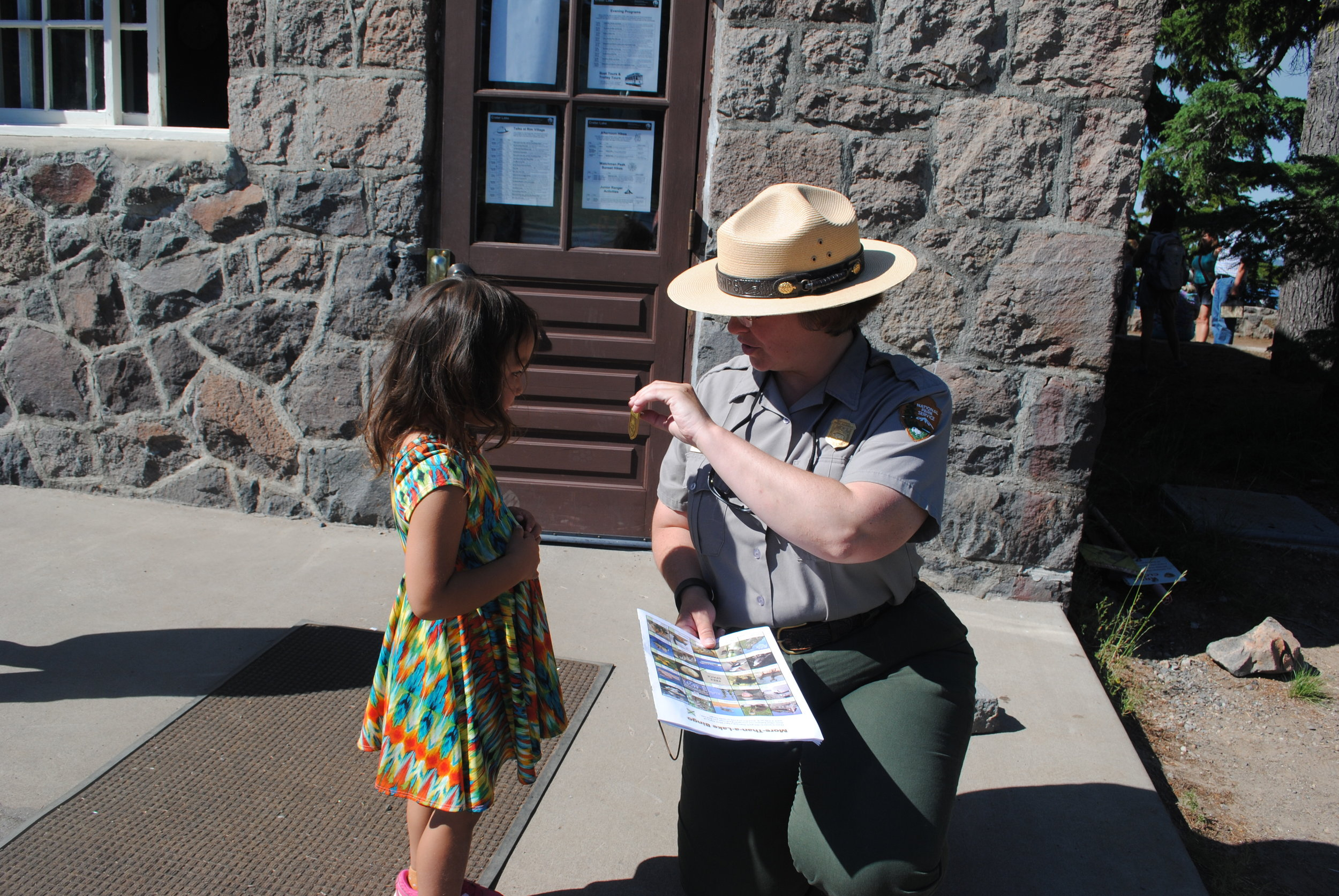 Olivia recieving here Junior Ranger badge for filling out her workbook.