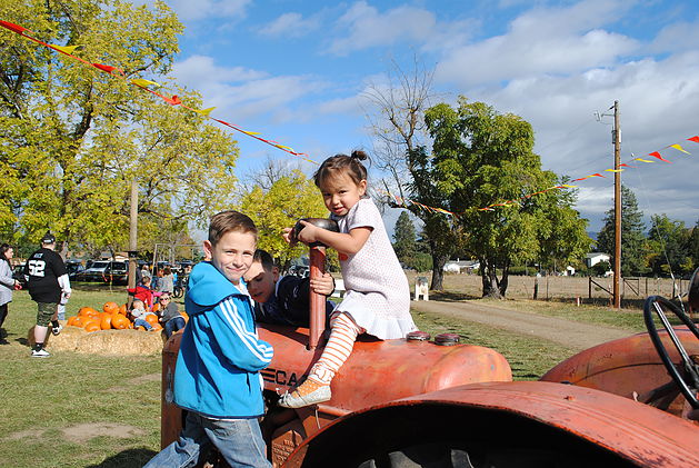 Trevor and Olivia on Tractor at Pheasant Fields Farm.jpg