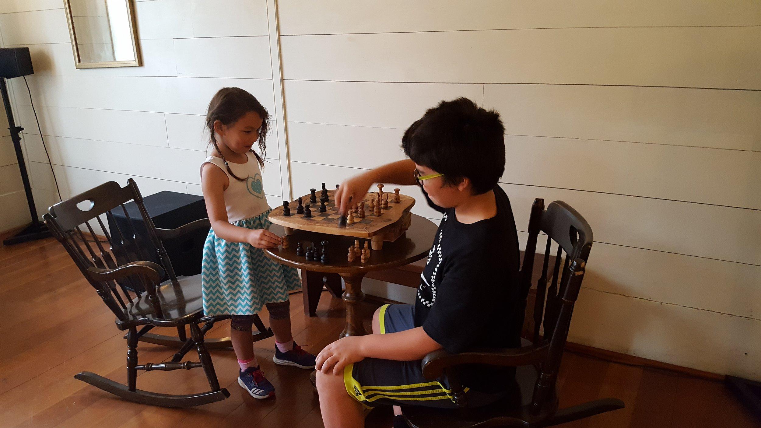 Kids playing Chess in the Ballrooom of Wolf Creek Inn.