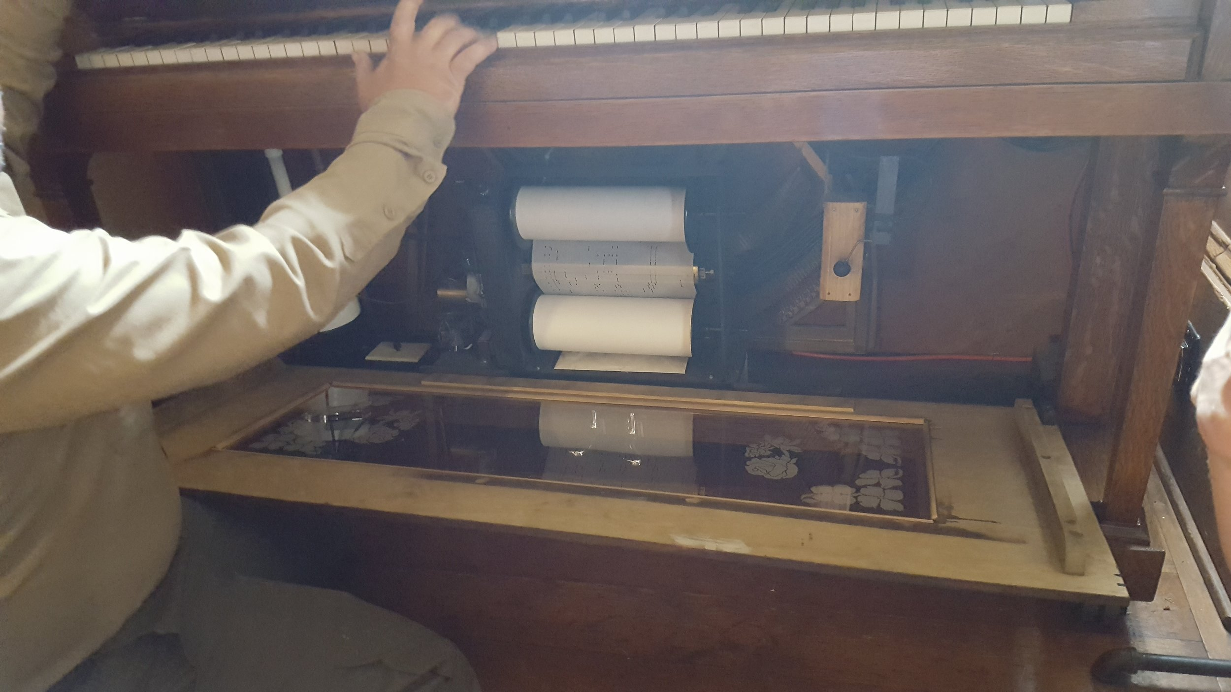Player piano in the men's tap room at the Wolf Creek Inn