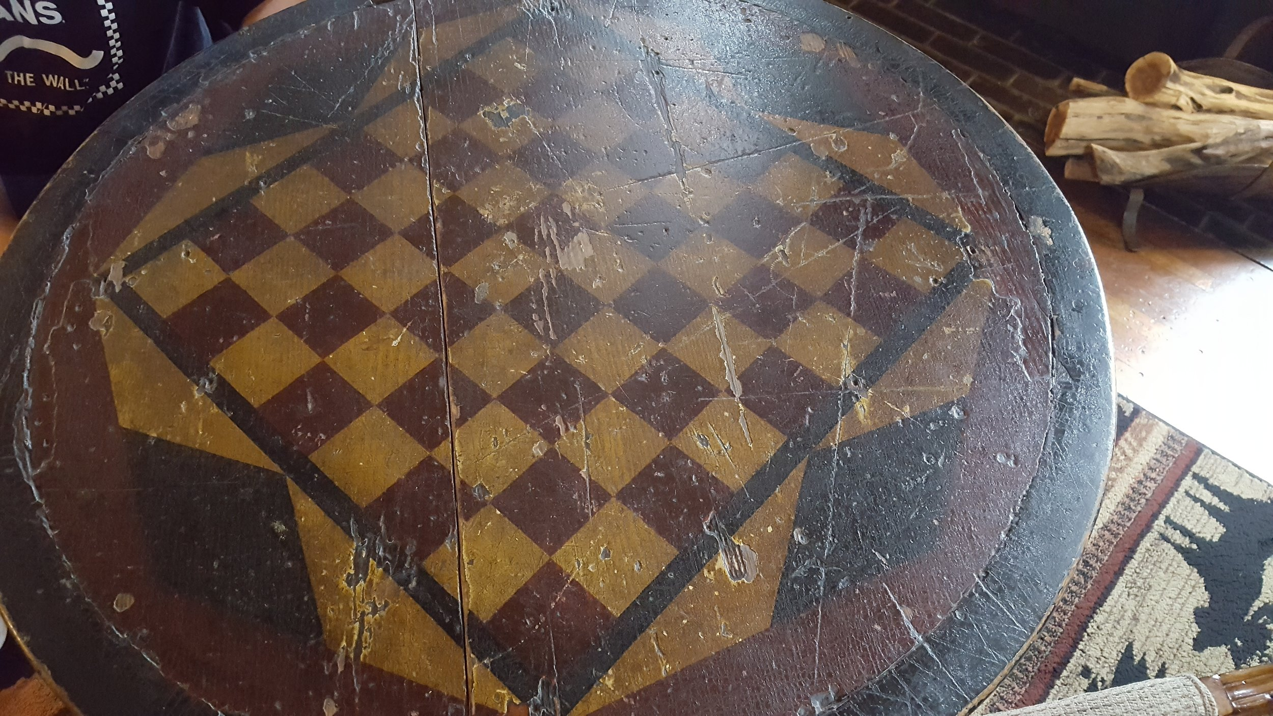 Antique checkerboard table in the men's tap room at Wolf Creek Inn