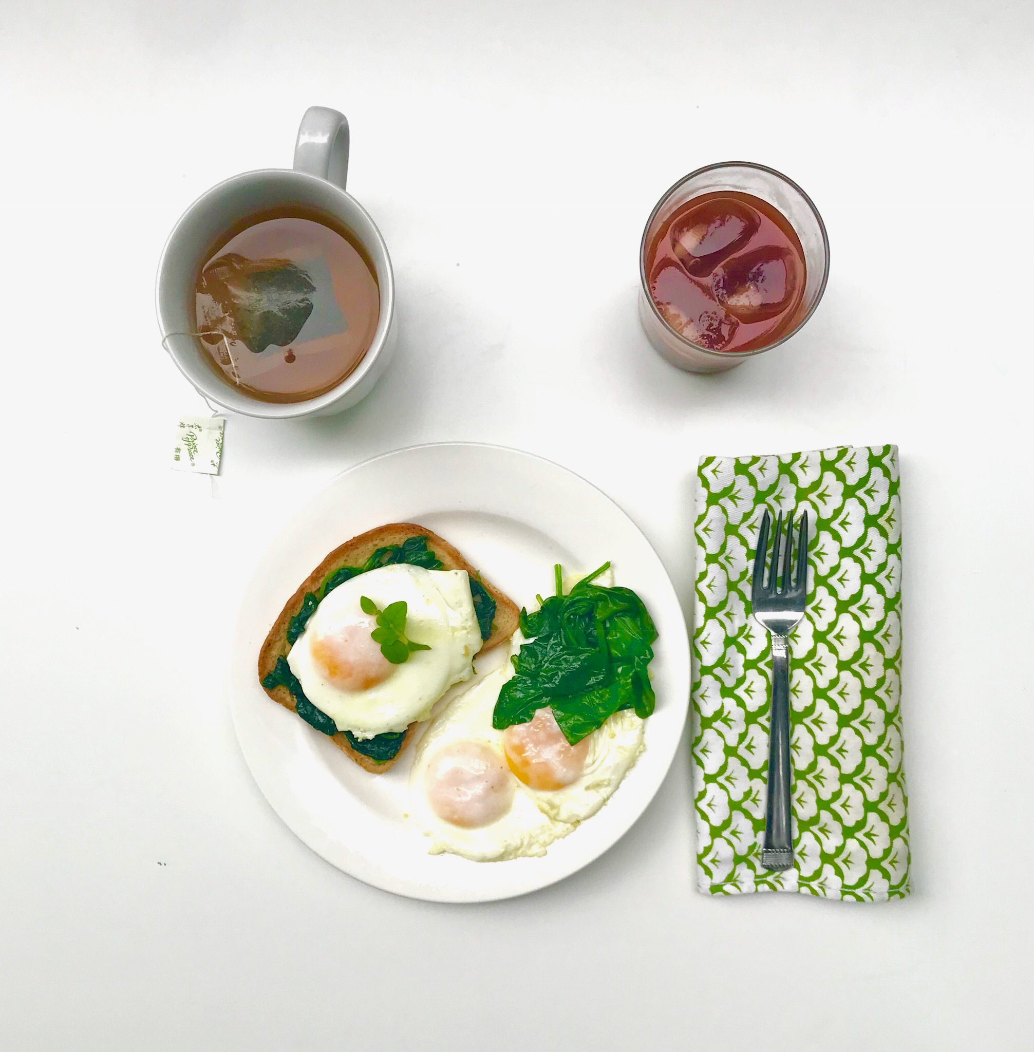 My Ideal Breakfast = Sauteed spinach, gluten free toast, perfect eggs, green tea, NingXia Red juice.