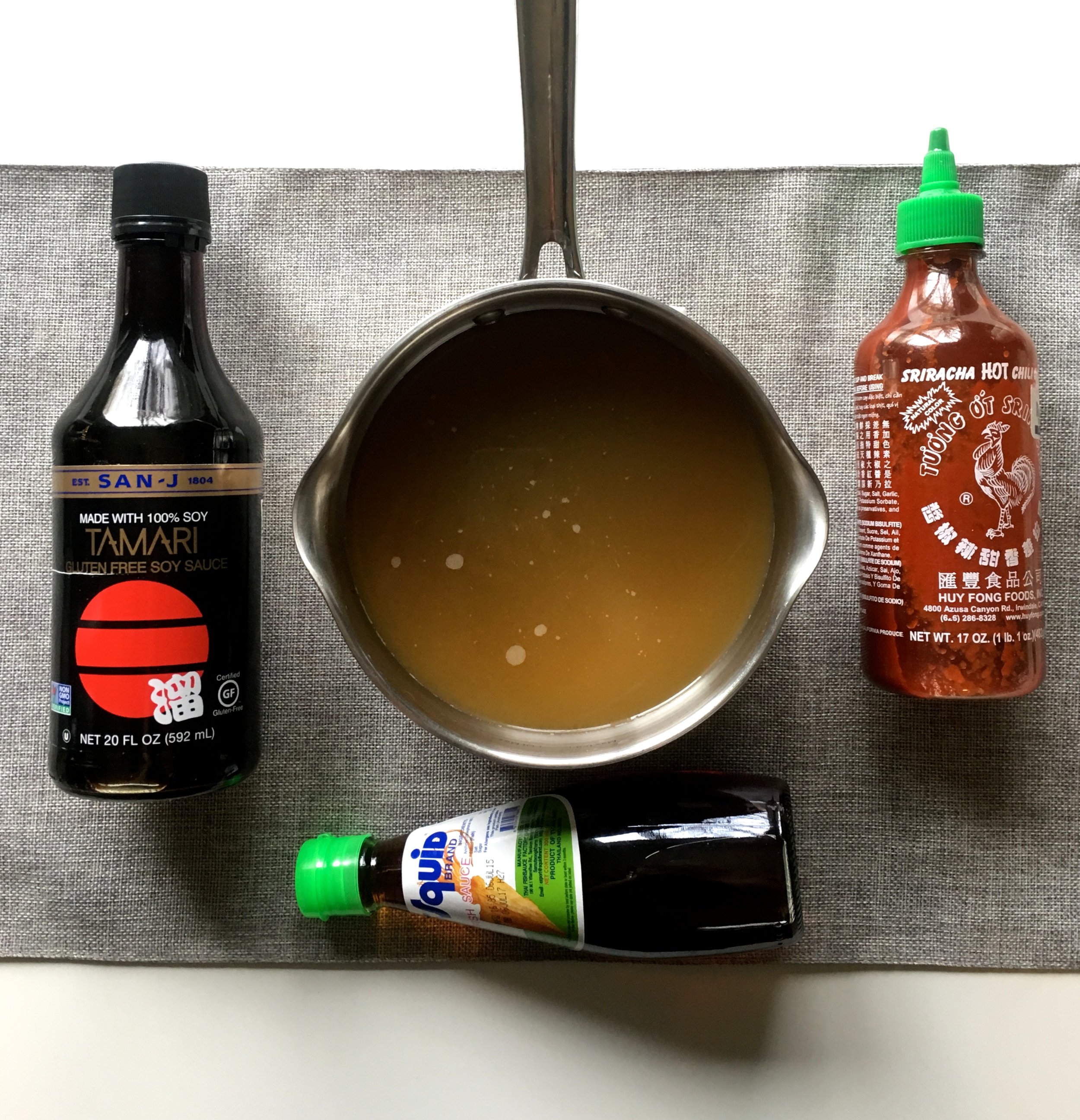 From left to right: Tamari, Fish Sauce, Sriracha.