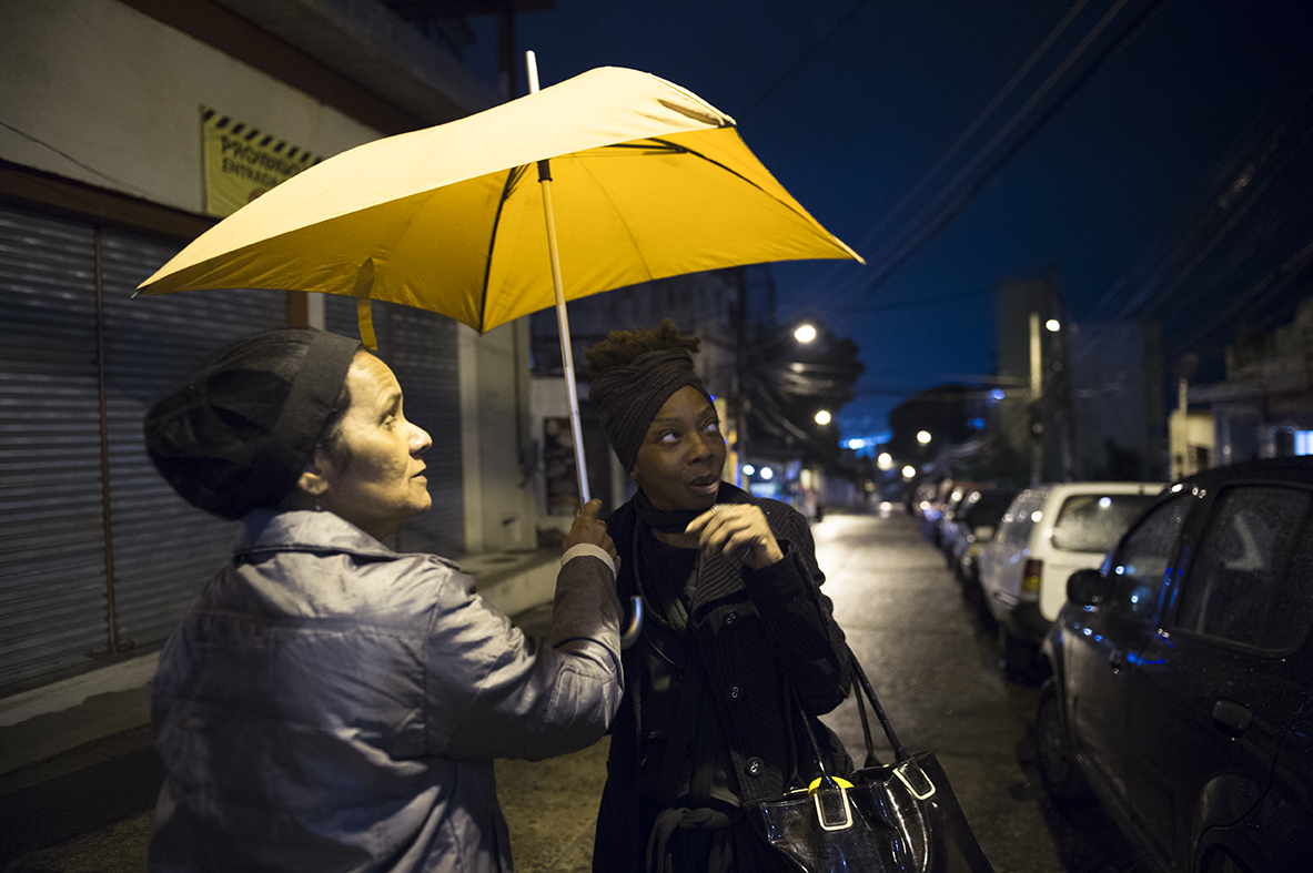 Residents chat on the streets of Vidigal favela on August 18, 2016.