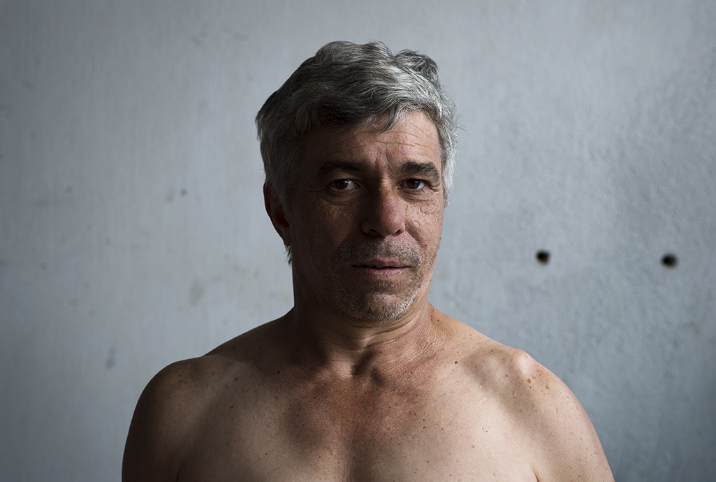Altair Roque poses for the camera at his home in Santo André favela, São Paulo, on August 11, 2016.