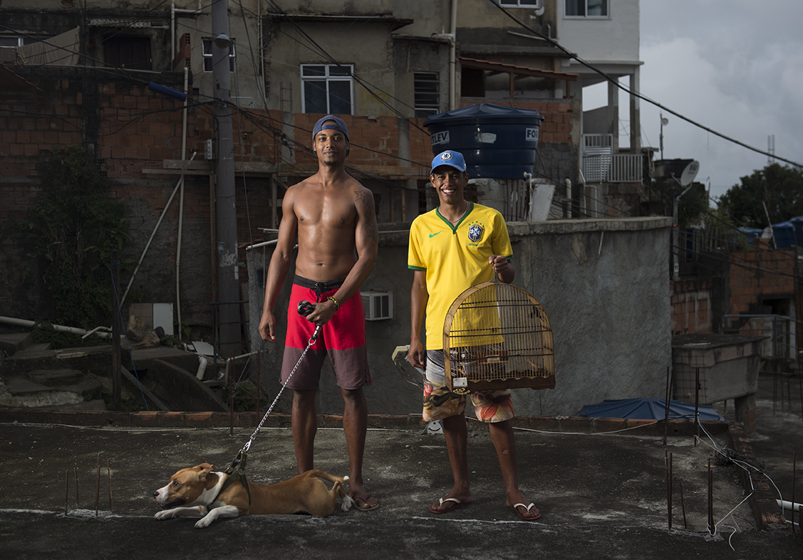 Aspiring model Rael Wenses (left) and his friend Leandro pose with their pet dog and bird which they call 'best friends.'