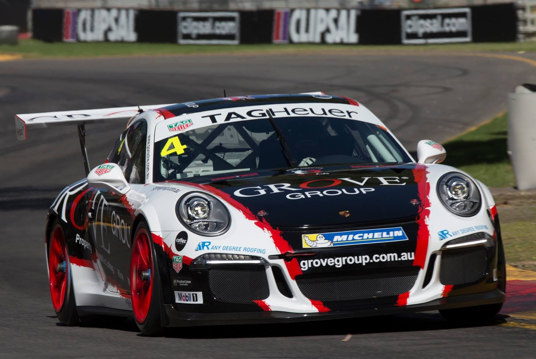 Stephen Grove is seen at the wheel of the Grove Racing Porsche