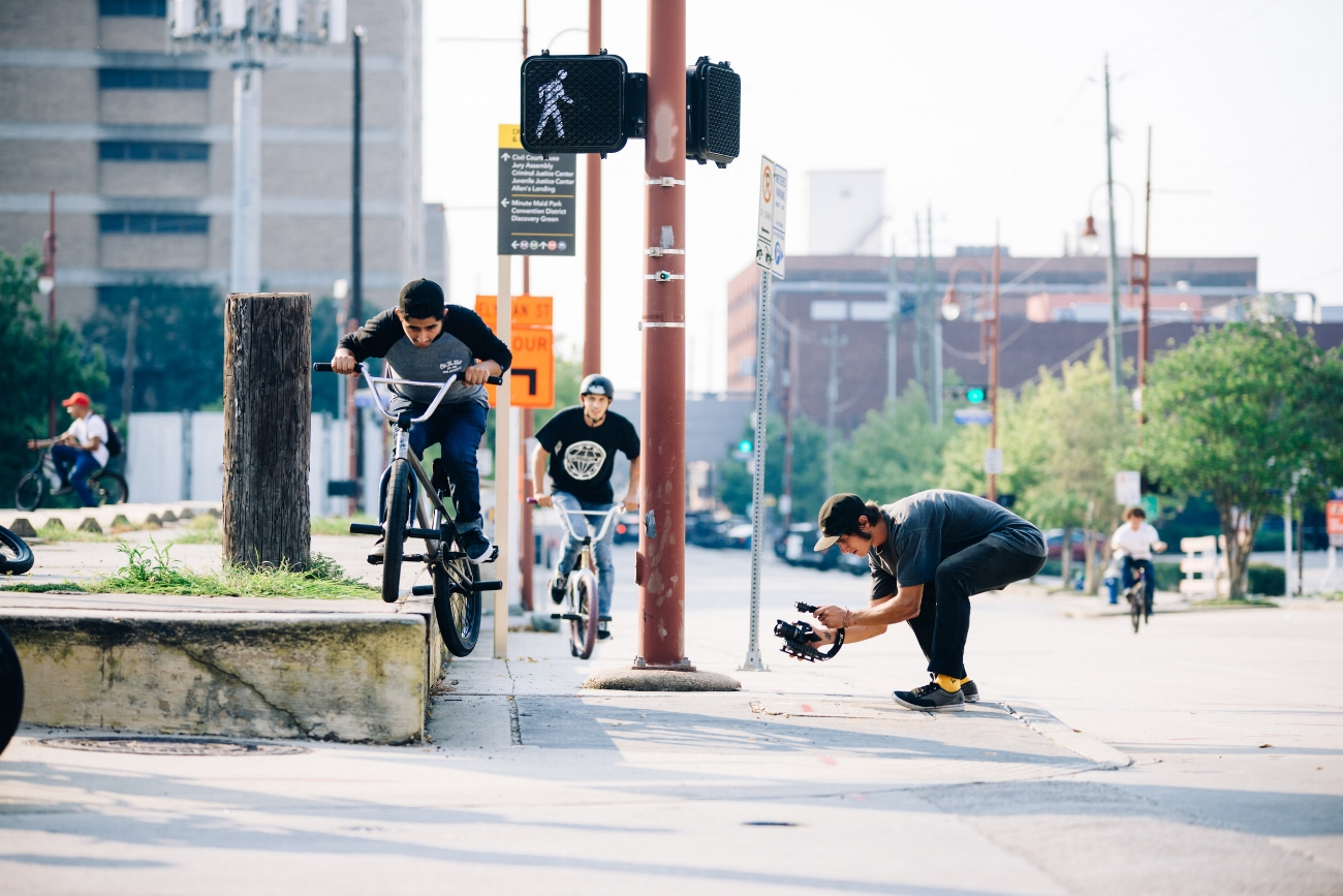Dylan filming a back to back clip with Nilderson and Daniel at a classic angle iron ledge in North downtown Houston.