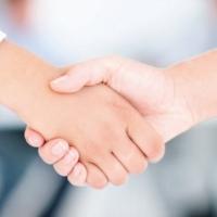 shaking hands women.jpg