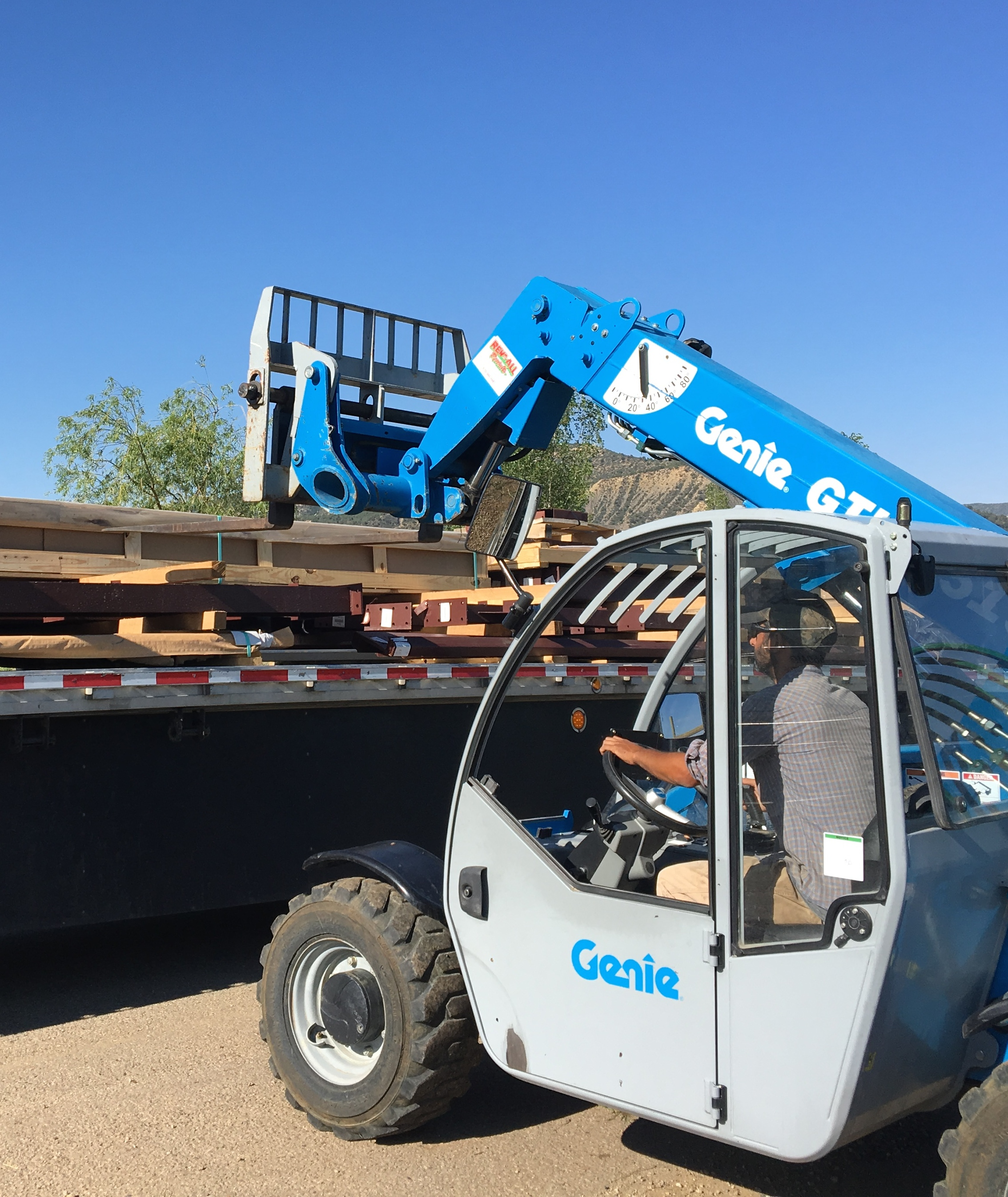 Mike unloading the semi with the materials for our steel building.