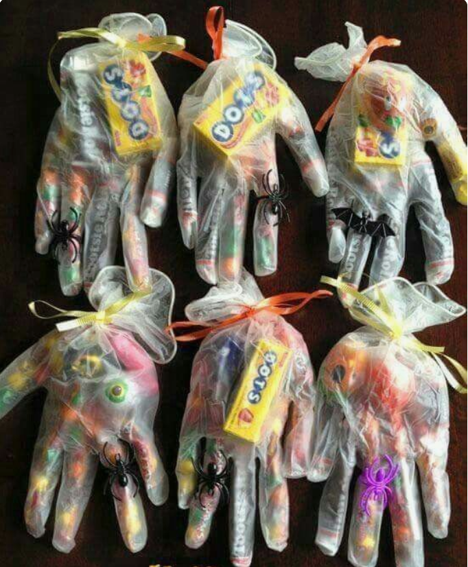 Shake their meathooks and see ya next year! - A pack of transparent gloves, an assortment of candy and a beautiful bow!