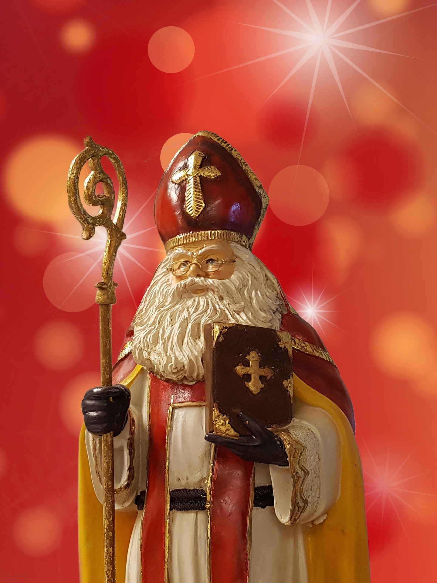 Saint Nicholas is clothed in the liturgical habit of the bishop with his mire and staff -