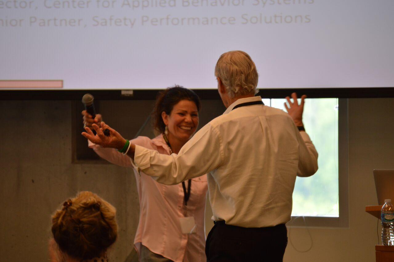 Krista Geller introducing keynote speaker, Dr. E. Scott Geller.