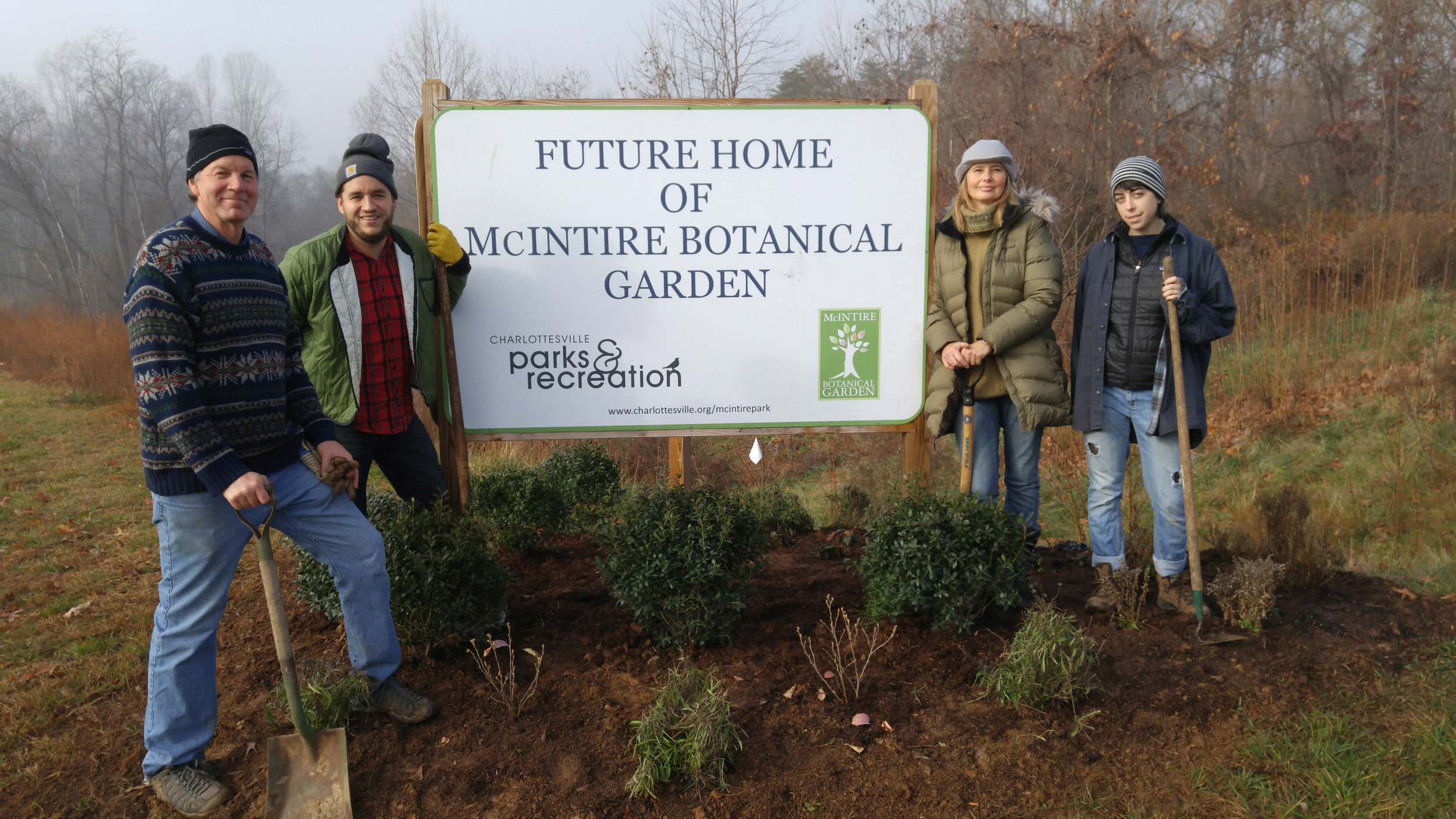 Kennon, Luke, Janna, and Sydna standing by the new sign.