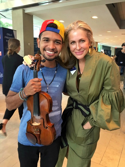 Venezuelan violinist Wuilly Arteaga, a 23 year old who was arrested in Caracas in July for playing the violin at the front lines,is pictured with Carmen Busquets in September playing at the Lincoln Center in New York after his release.