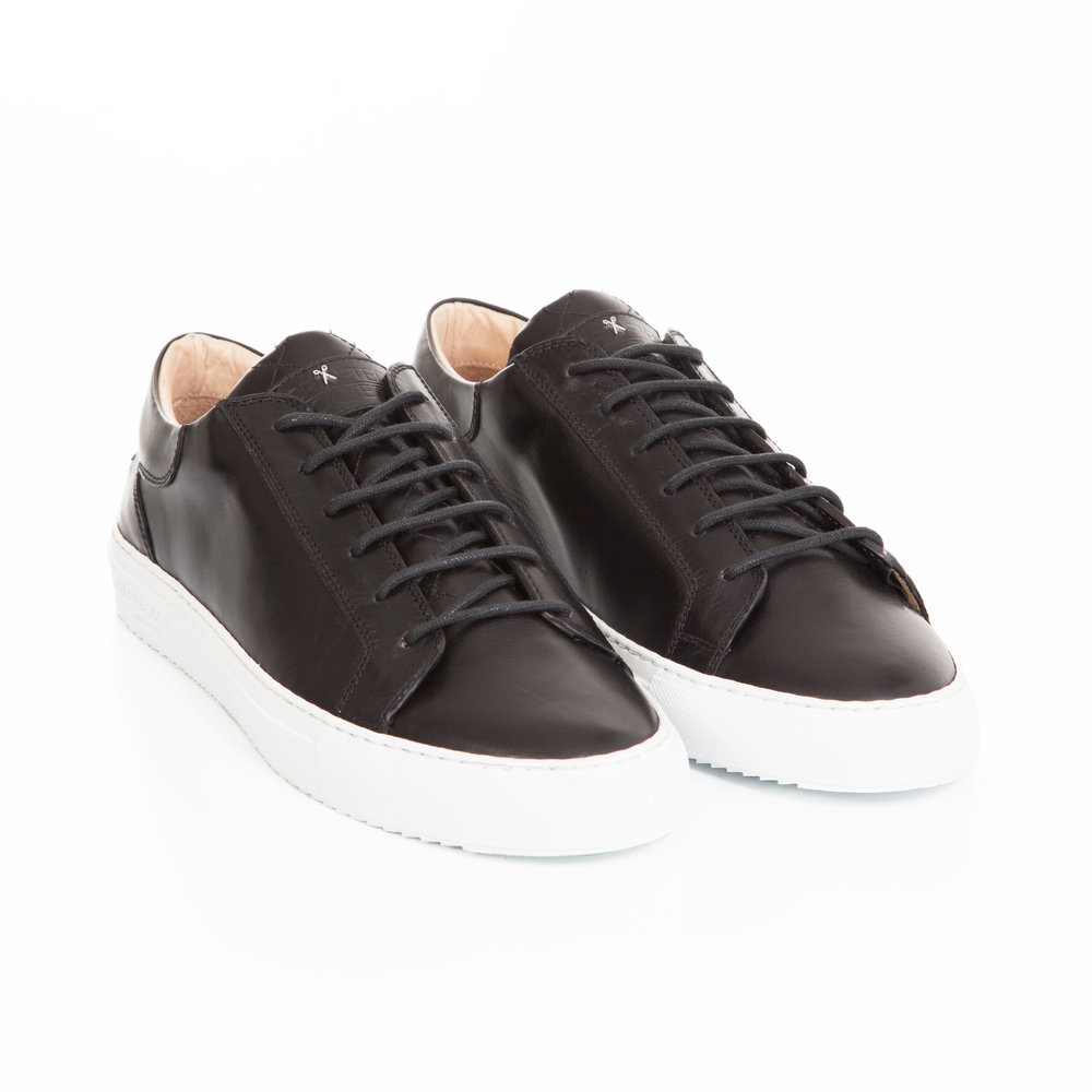 Black sneakers by Crafted Society
