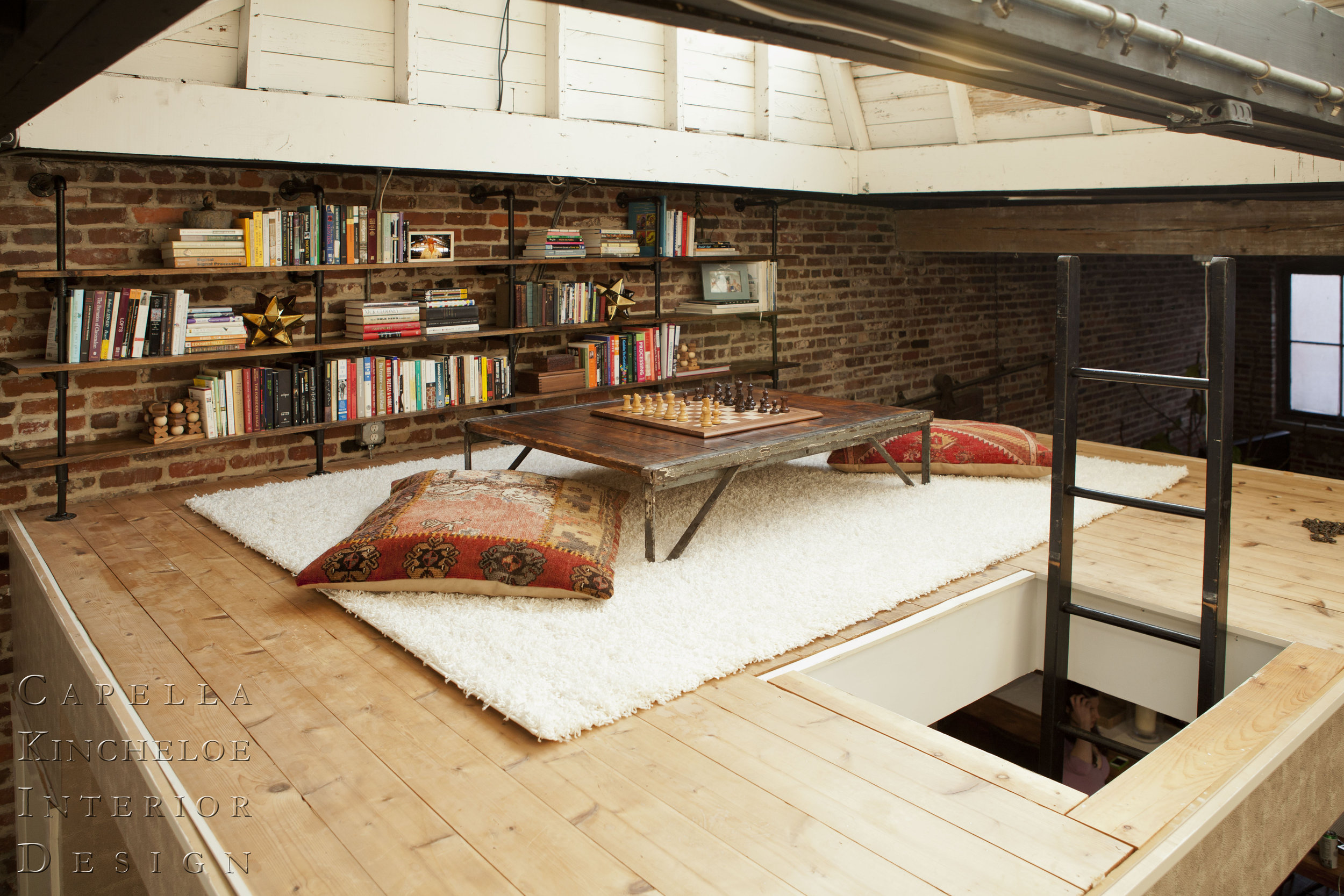 Atlanta Loft Library: brick walls game space reading nook