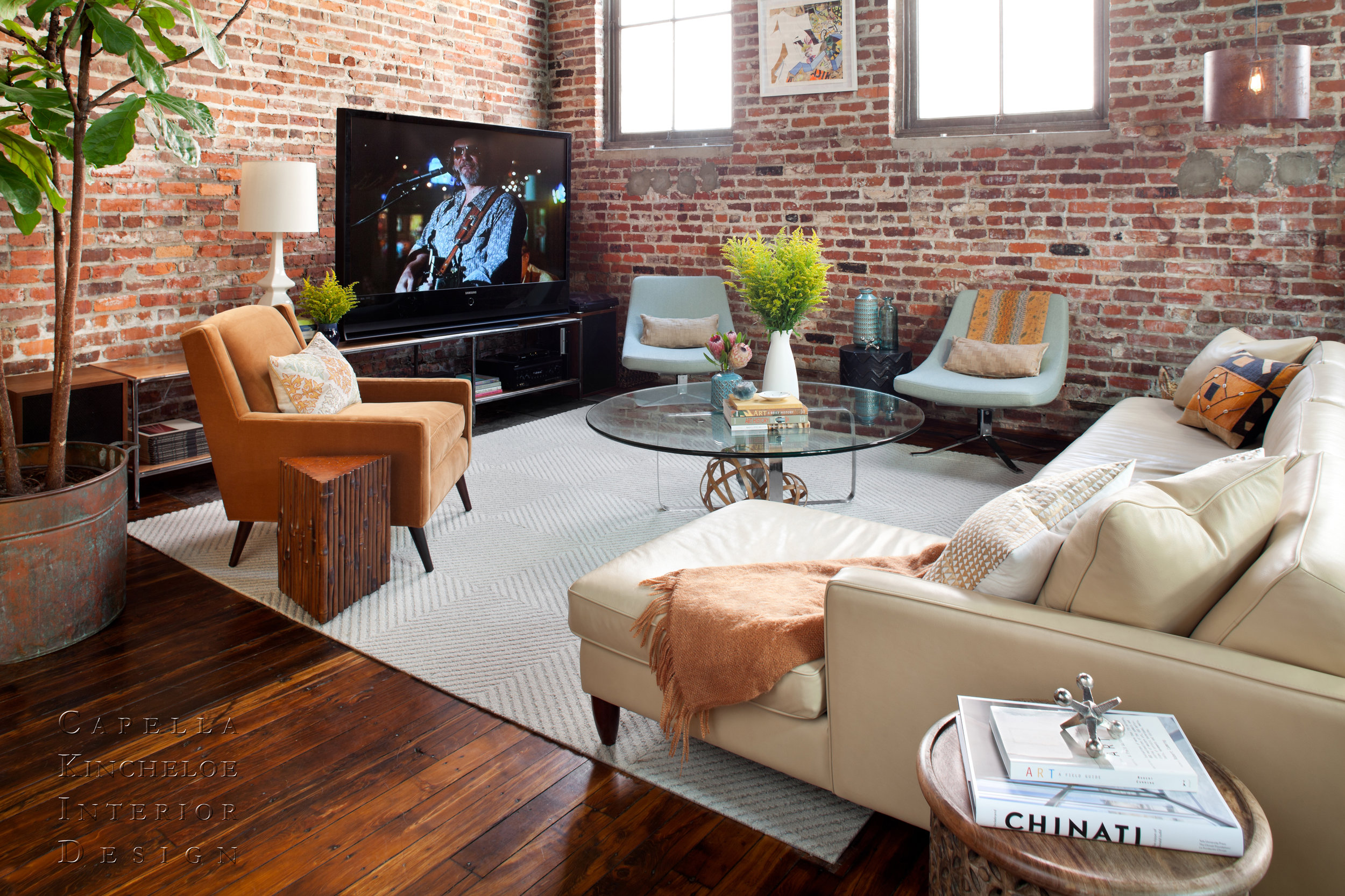 warehouse living in Atlanta, brick walls, American Leather sofa, Room & Board Chairs, fiddle leaf fig tree open concept living