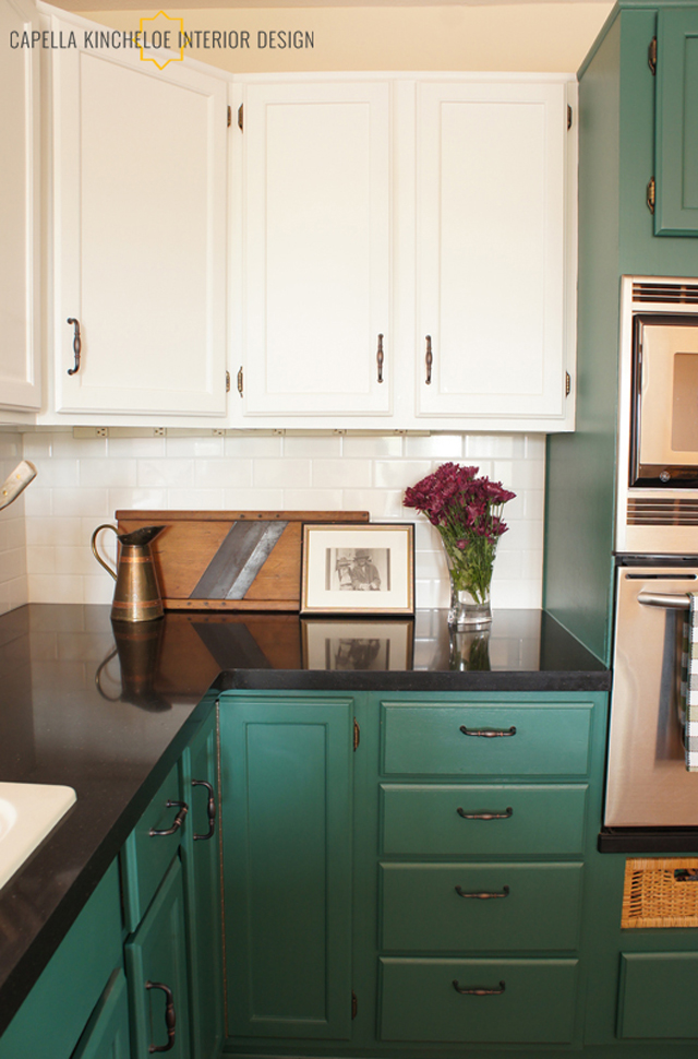 Green kitchen cabinets, Benjamin Moore Spinach, black quartz countertops