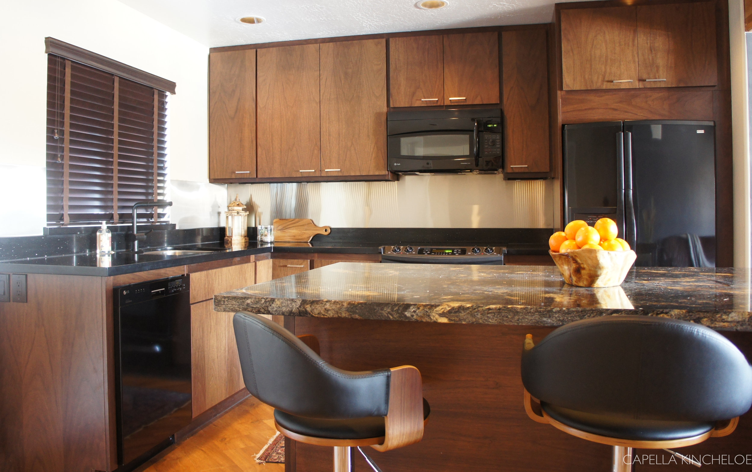 bachelor kitchen, European walnut cabinets, black granite, masculine kitchen, stainless steel backsplash