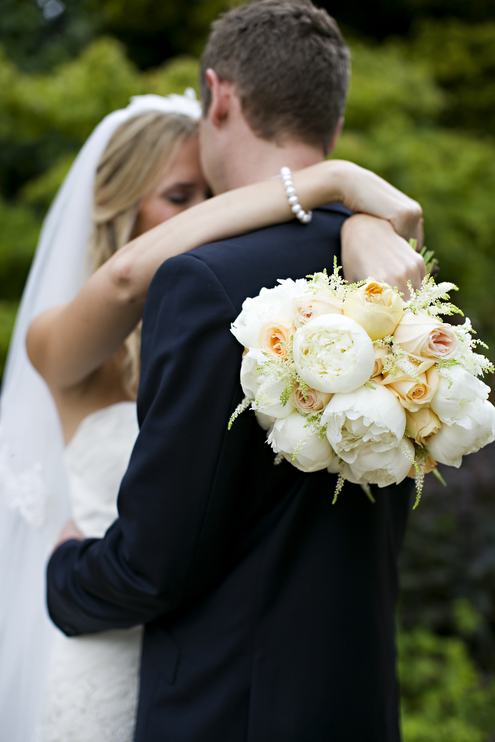 Soft peach peony bouquet and bridal flowers from Derbyshire Florist, Tineke.
