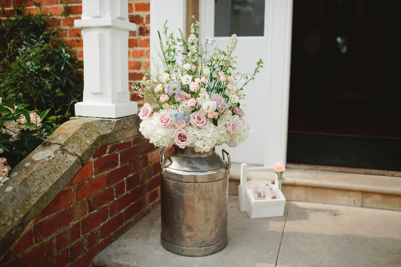 Milk churns at reception by Tineke