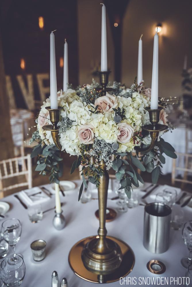 Floral candelabra table decoration at Swancar Farm Nottinghamshire