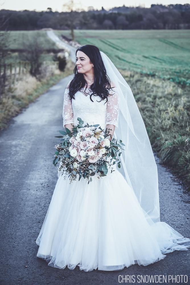 Soft pastel bridal bouquet with eucalyptus at a Swancar Farm winter wedding, Nottinghamshire.