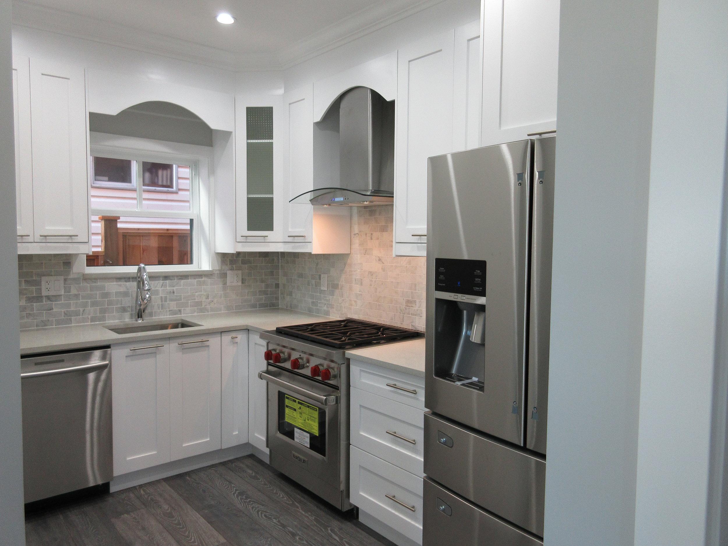 pic08 - gourmet kitchen with gas range, four door refrigerator, and quite dishwasher.JPG