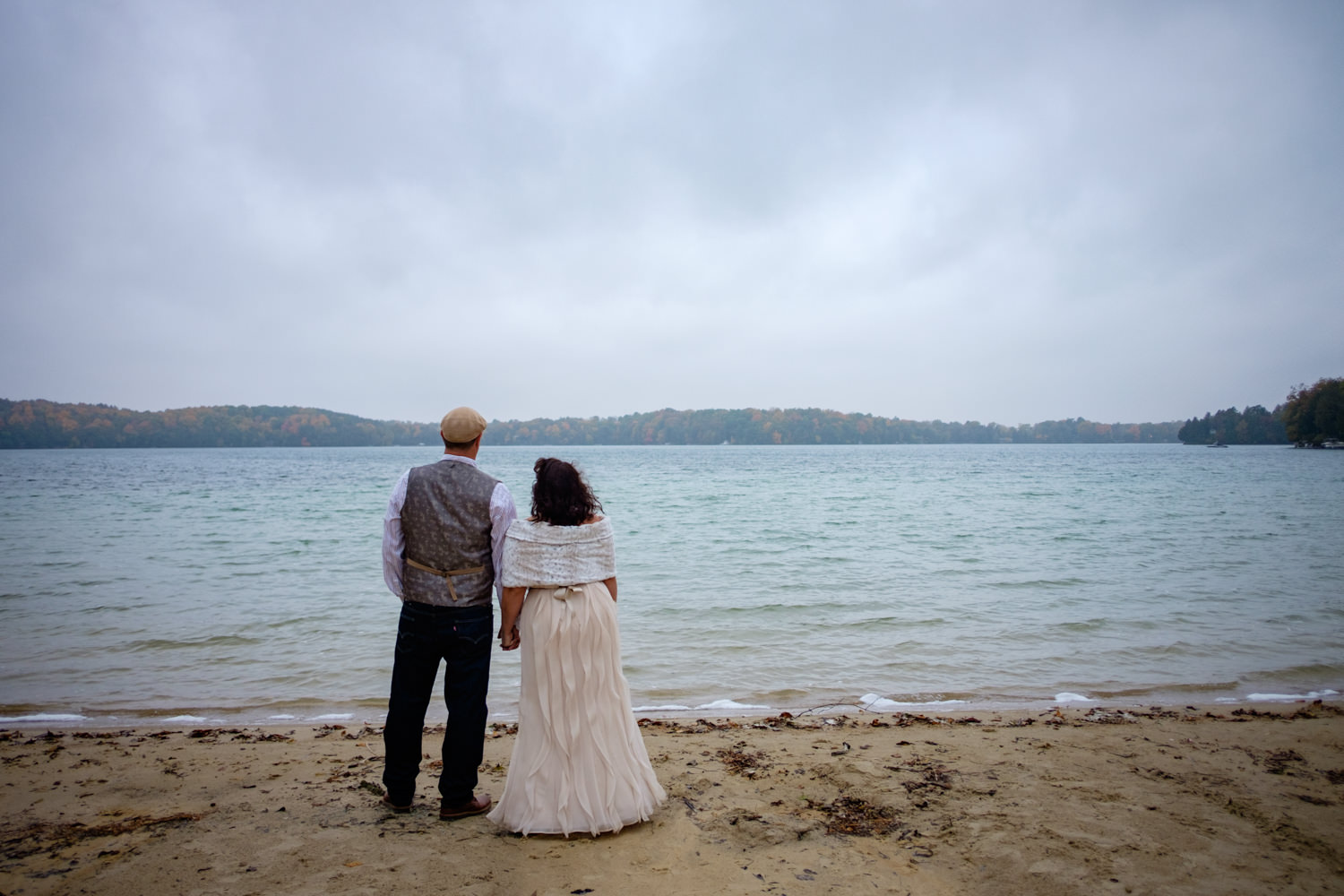 Bride and groom on the beach at the Osthoff Resort in Elkhart La