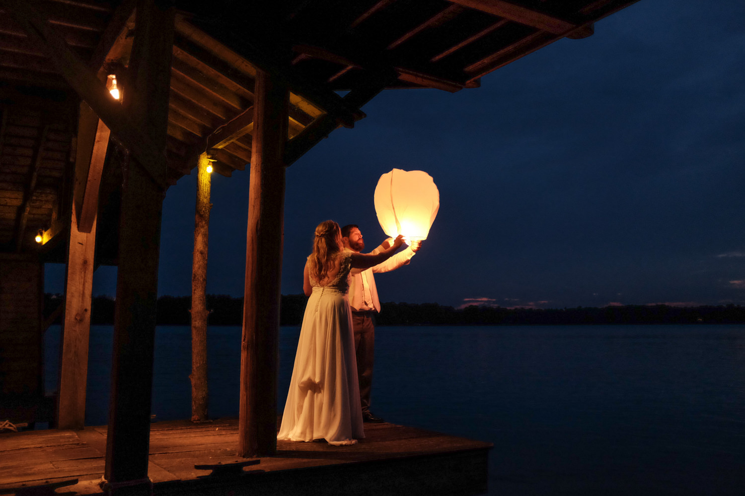 Releasing Chinese lanterns from the boat house at Stout's Island