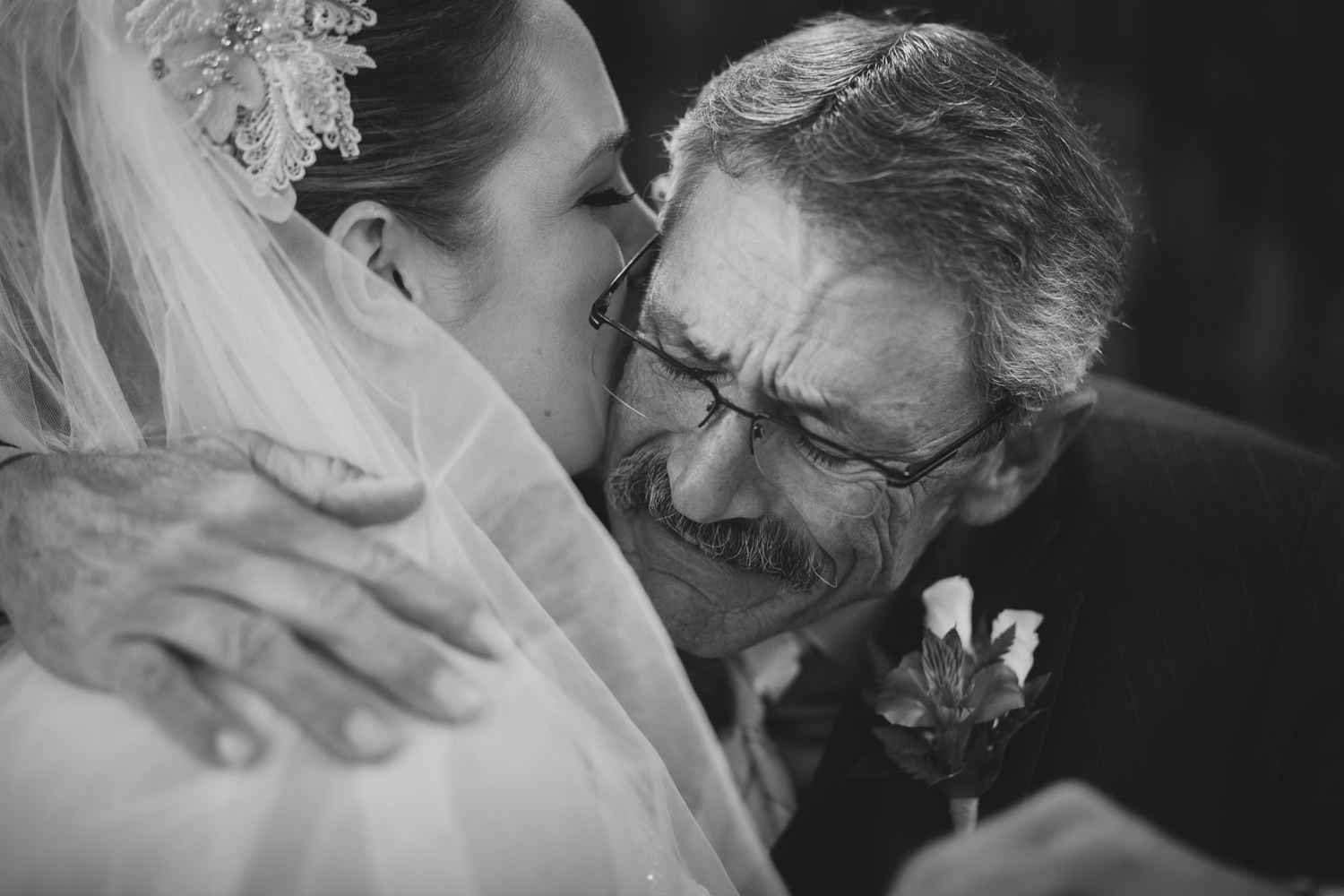 Bride and her father's emotional embrace before the wedding cere