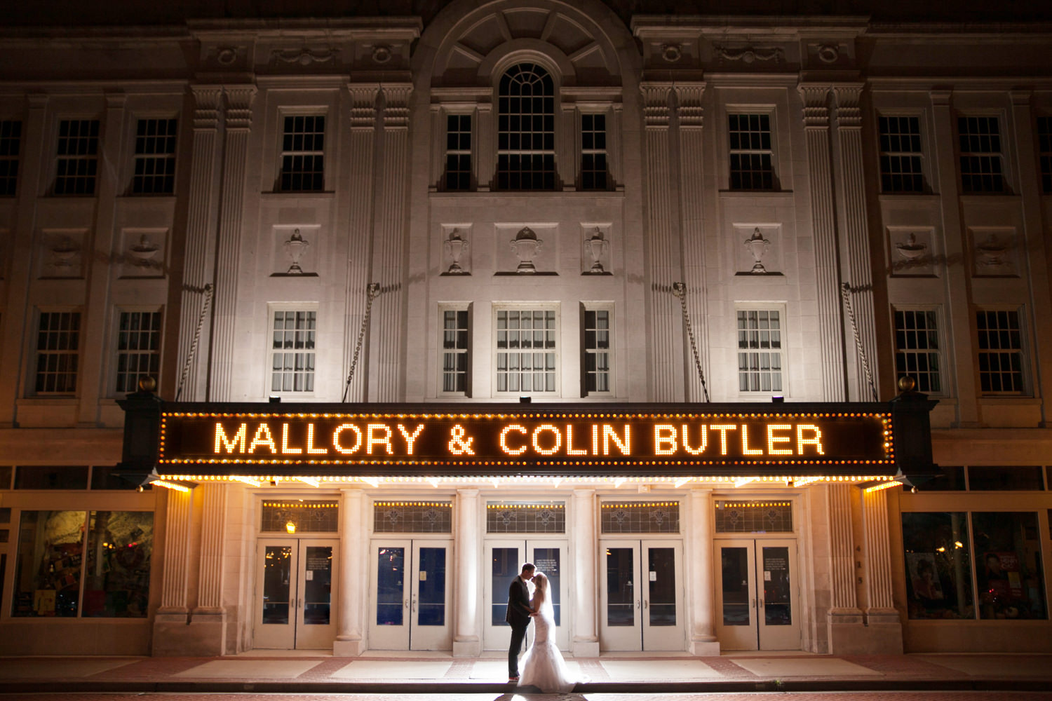 Dramatic night time marquee portriat at a Grand Theater wedding
