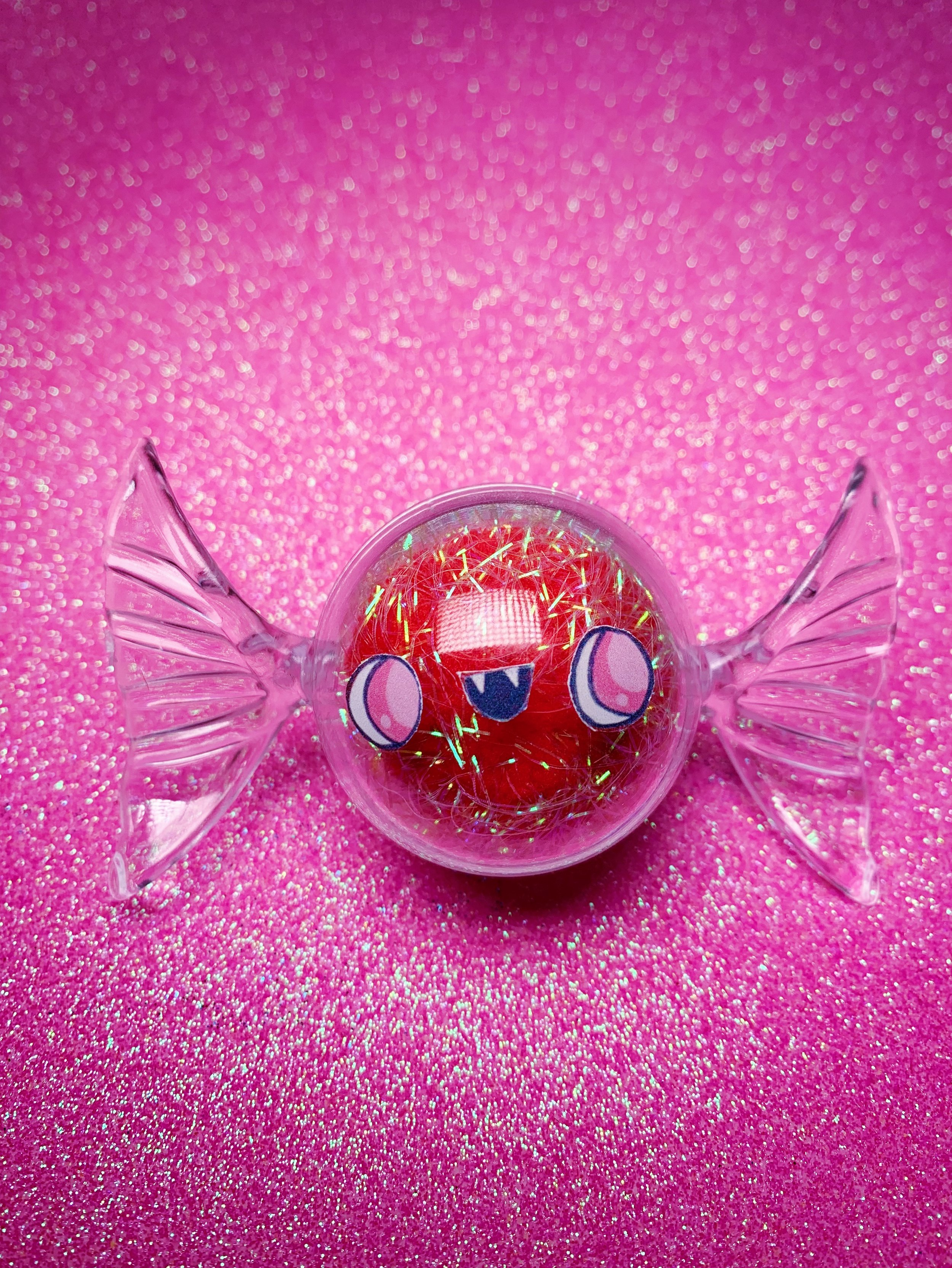 Tiny red candy friend. Click to shop.