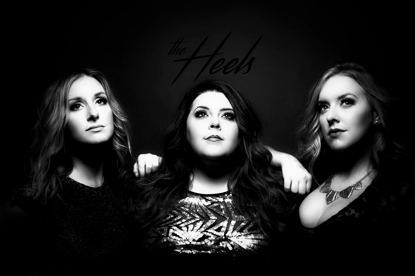 The Heels are a 2016 BCCMA Award winning female Country music trio based in Vancouver BC. With past solo careers spanning a rainbow of genres, The Heels - Bobbi Smith, Brittni Dominelli & Kyla Rawlins have joined forces as a powerful female presence. The trio are known for three part harmonies, sassy lyrics, unforgettable melodies and outstanding heels!   www.theheelsmusic.com
