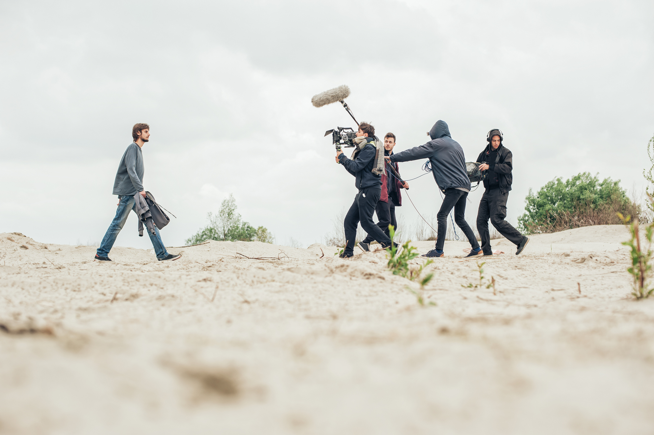Behind-the-scene.-Film-crew-filming-movie-scene-outdoor-682180238_2125x1414.jpeg