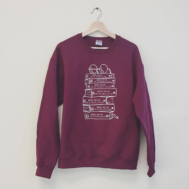 They HP book stack sweatshirt now available in white ink! #hipsterwizard #harrypotter #reading #literature #favoritebook #bookstack #cool #gift #valentinesday #valentinesgift #teacher #readingisfun #magic
