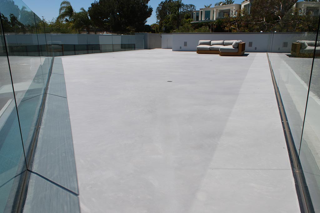 Roof deck was resurfaced and leveled with with X-Bond Seamless Stone