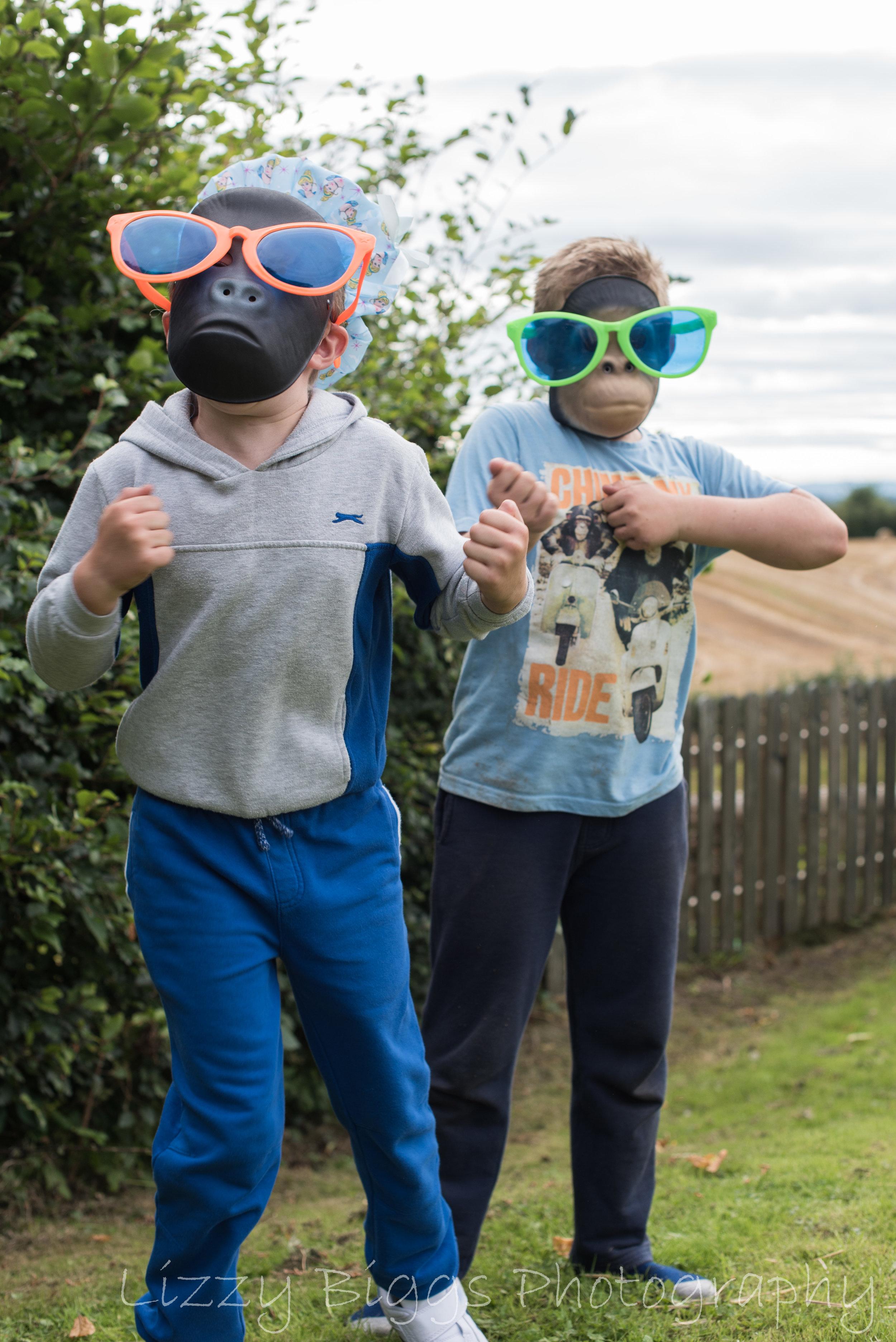 Boys in monkey masks dancing