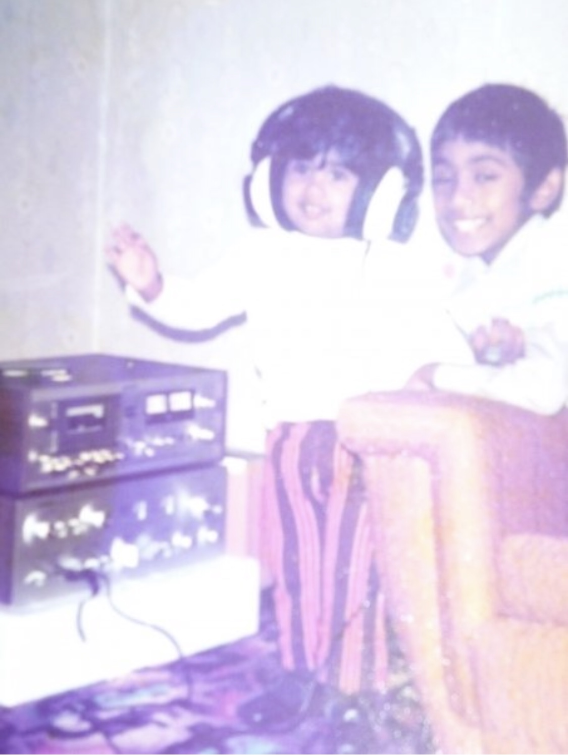 My big brother, by my side so I didn't fall as a toddler busy fake  conducting the orchestra to music only I could hear. The rest of the family just had to guess which song by my master conducting. FYI it was Grease, not sure of which track but I was (still am) obsessed with the  movie and entire soundtrack.