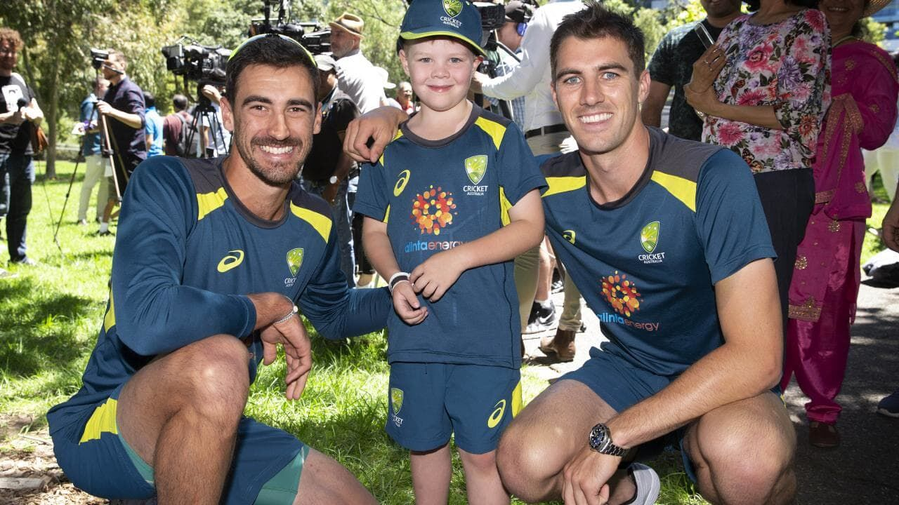 Archie with Aussie cricket players courtesy of Herald Sun