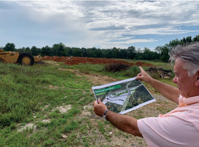 DEVELOPER STEVE MADDOX SHOWS THE SITE PLAN FOR HIS GRASSY CREEK DEVELOPMENT AT THE INTERSECTION OF SCHAAD ROAD AND OAK RIDGE HIGHWAY.