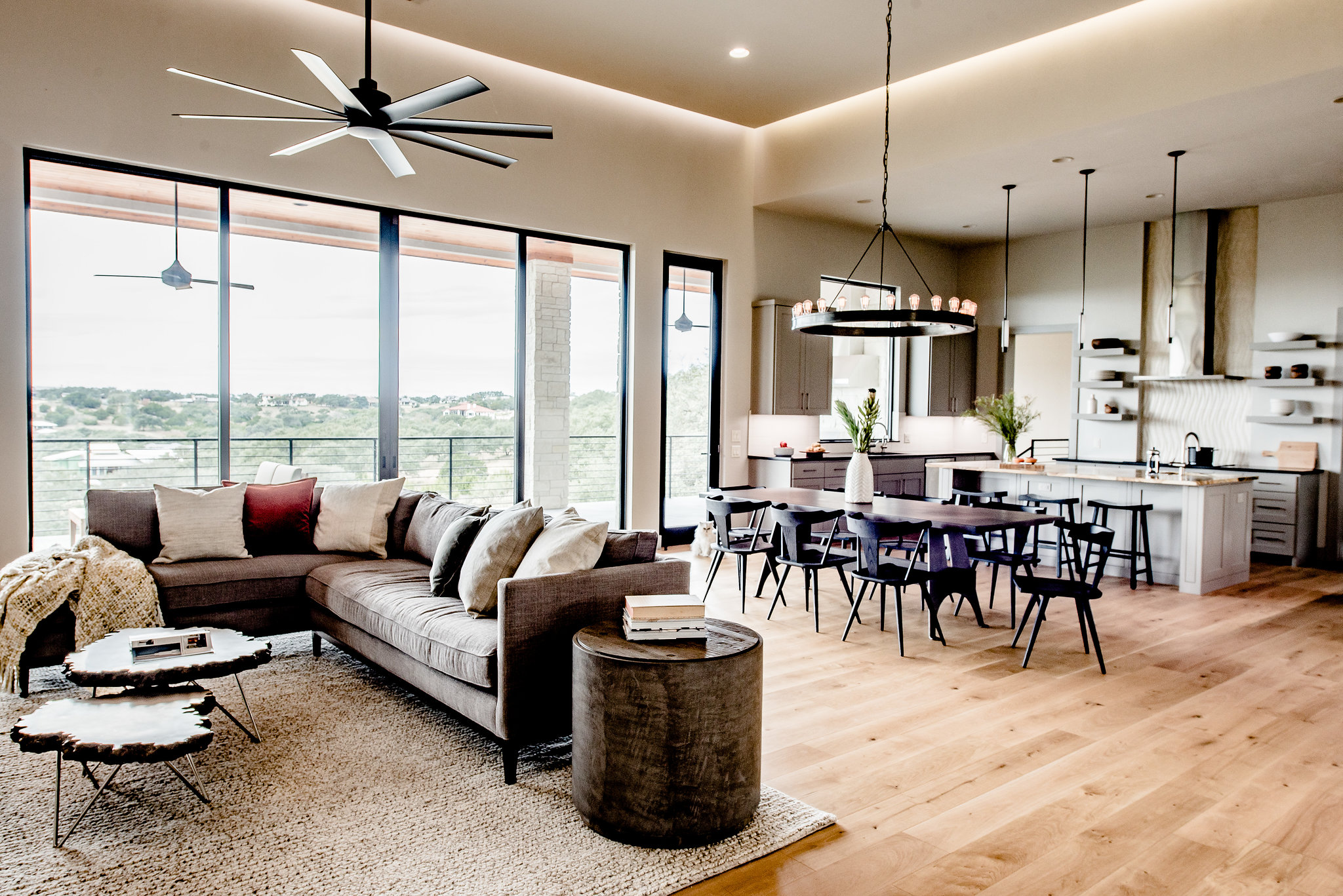 When determining size, pay attention not only to the relationship of the rug with the furniture feet, but side tables can also be a factor. In our project above the rug was sized to ensure the side table could sit cleanly on the rug. Rug provided by Black Sheep Unique. Photo credit: An Indoor Lady.