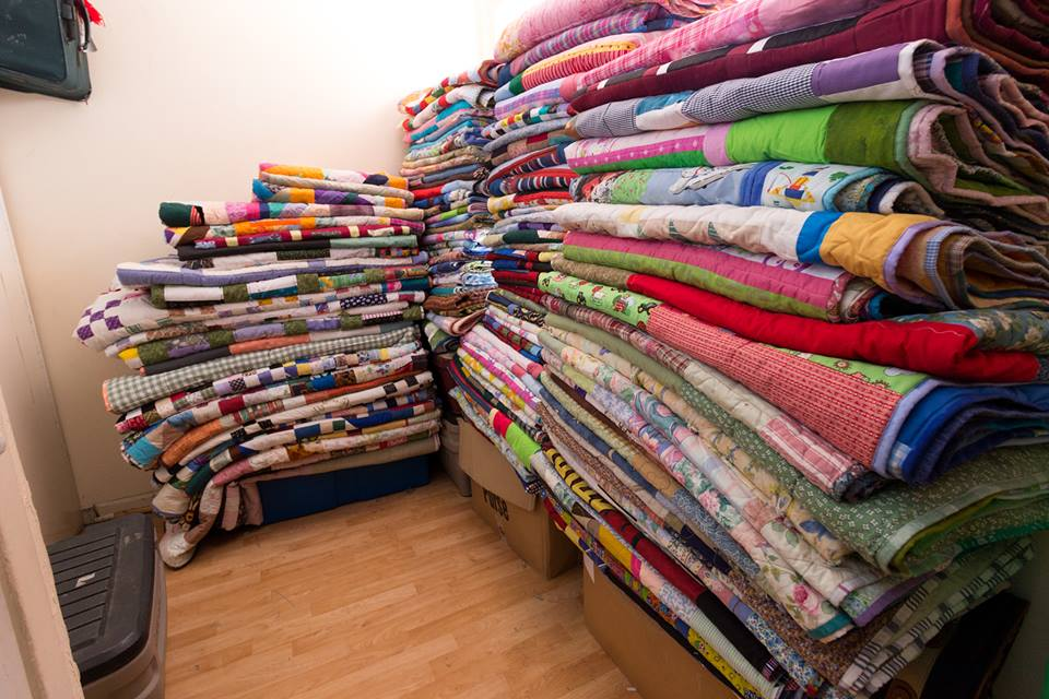 Here is a picture of 123 quilts that I had available at one time this year. I so appreciate all of you who have helped me be able to finish up this many. Some of you have donated tops, fabric, blocks, and of course, money so that I can buy supplies to be able to make these for people in our area.
