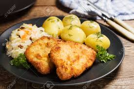Typical breaded pork chops and potatoes. It's delicious, BTW!