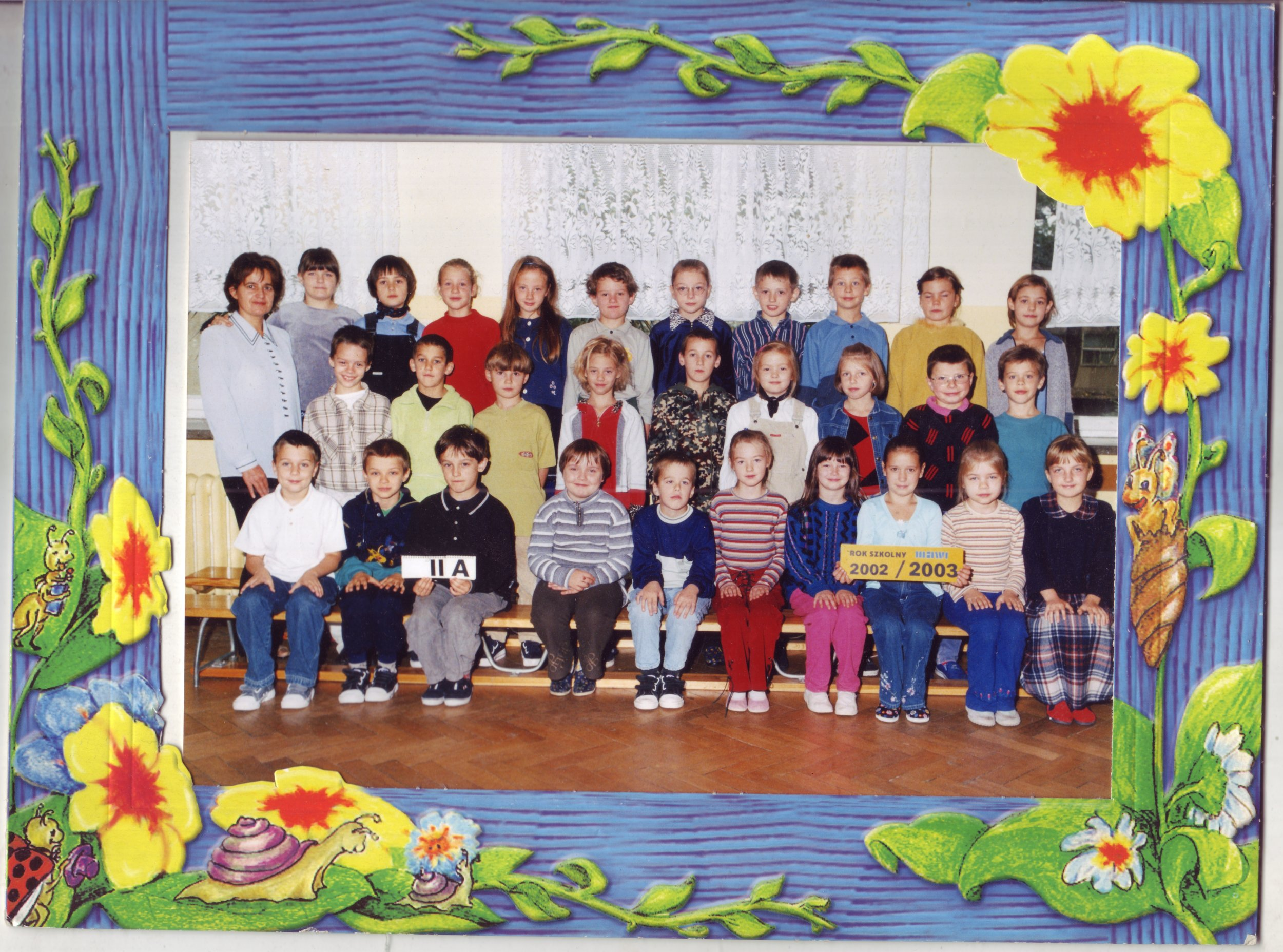 This is my daughter Lydia's second grade class picture. She's in the front row in the blue sweater/hot pink pants.