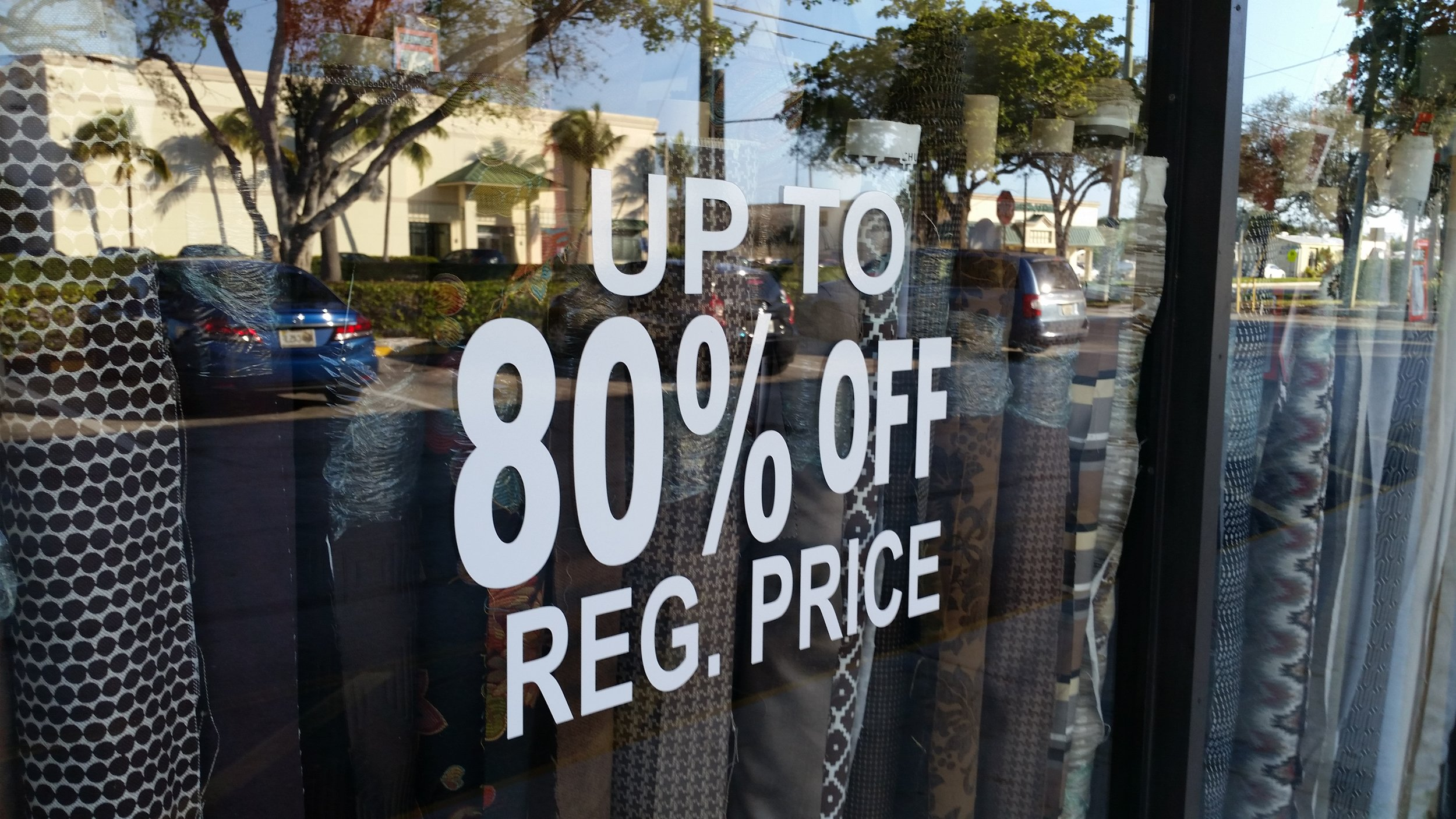 A sign like this will get you you excited, if you're a bargain hunter, like I am. But... I was dismally disappointed once I peered into the window and saw the prices per yard.