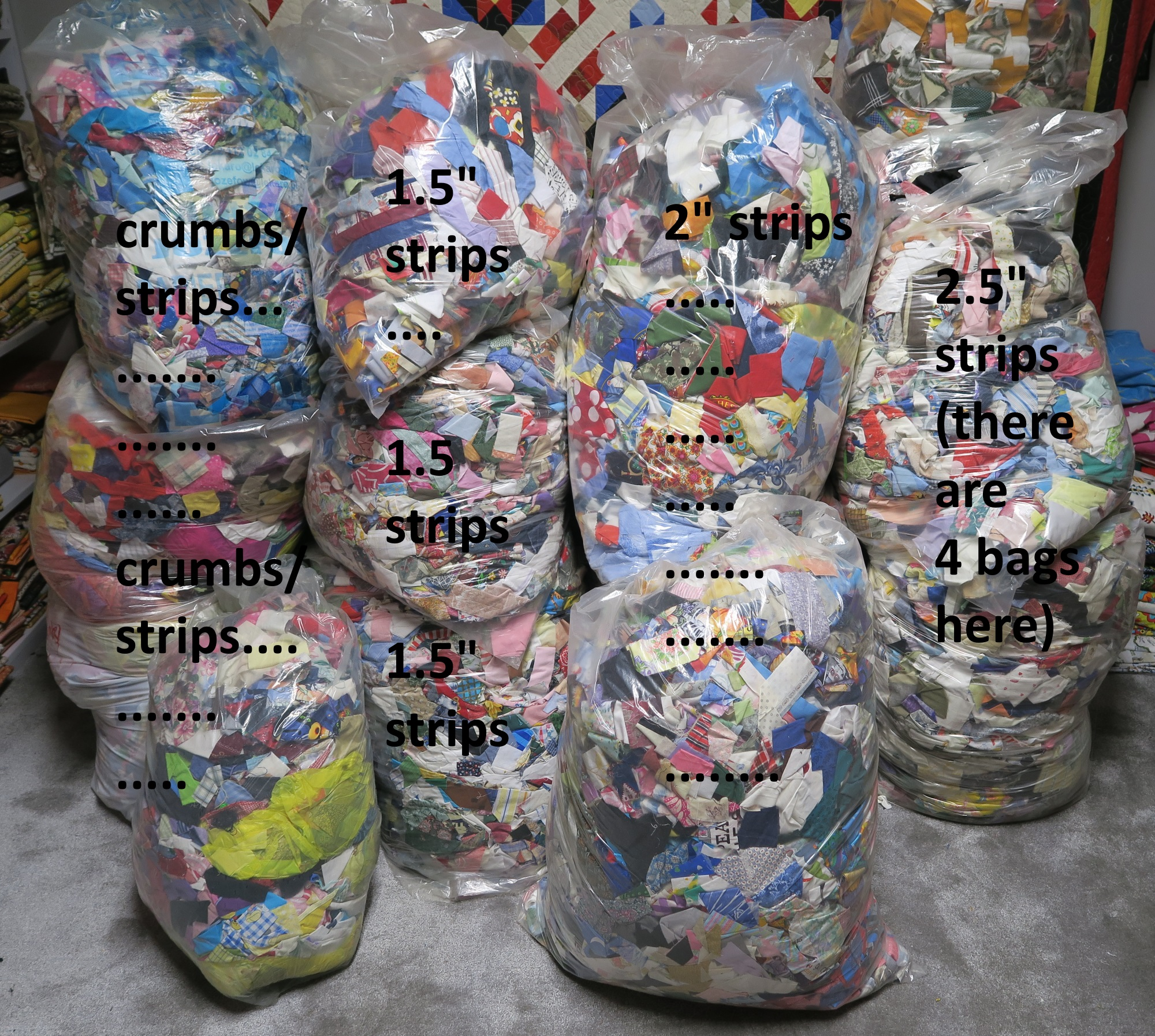 I do have something like 4 bags of crumbs and strips. That is crazy! But I'd rather have them in this form than in the previous form! This way they are quite usable - even it means I have to pull strips out of bags. I know many of you sort yours by colors - maybe at some point I will do that. I'm sure they would take less space if they were rolled into nice neat piles. Maybe someday if I get too tired of sewing I'll tackle that. It would be pretty cool, actually, to have them all stacked in boxes like that.